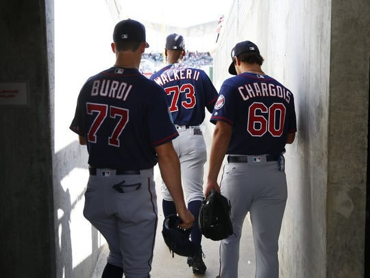 Minnesota Twins pitcher Nick Burdi (77), outfielder Adam Brett Walker II (73) and pitcher J.T. Chargois (60) take to the field Wednesday, March 2, 2016 at JetBlue Park in Fort Myers, Fla. The Red Sox faced the Twins at JetBlue Park during a spring training game. The Twins won 7-4. (Corey Perrine/Staff)