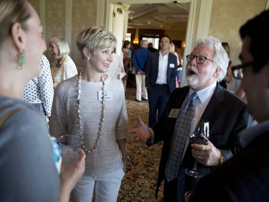 Sandi Moran, left, trustee of the Naples Winter Wine Festival, listens to Chuck Hallberg, right, prior to the Naples Children & Education Fund Great Expectations 2016 Grant Awards Ceremony at the Bay Colony Golf Club Monday, March 14, 2016 in Naples. The NCEF raised over $11 million dollars for local organizations who specialize in providing education and care to underprivileged and at-risk youth. (Luke Franke/Staff)