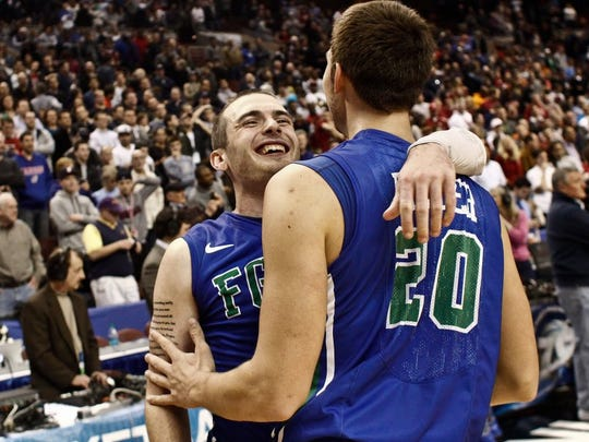 Scott McIntyre/Staff FGCU's Brett Comer celebrates with Chase Fieler after defeating Georgetown University at the Wells Fargo Center in the NCAA tournament on Friday.