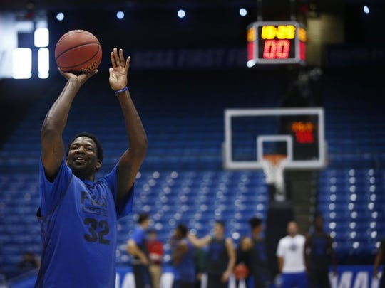 Florida Gulf Coast forward Antravious Simmons (32) smiles while hitting free throws Monday, March 14, 2016 at the University of Dayton Arena in Dayton, Ohio. The Florida Gulf Coast men's basketball team met with the media and hosted practice in preparation to take on Fairleigh Dickinson University (Teaneck, N.J.) Tuesday. The First Four   ' a play-in game to the NCAA Tournament   ' the winner will face top seeded University of North Carolina in Raleigh, N.C. Thursday. (Corey Perrine/Staff)