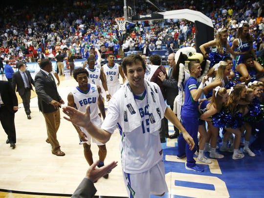 Florida Gulf Coast forward Filip Cvjeticanin (15) walks off the court with teammates after the win Tuesday, March 15, 2016 at the University of Dayton Arena in Dayton, Ohio. Florida Gulf Coast faced Fairleigh Dickinson in the First Four, a play-in game to the NCAA Men's Basketball Tournament. FGCU won 96-63. (Corey Perrine/Staff)