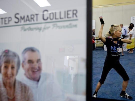 Tai chi instructor Liz Beacton-Read does demonstrations during the senior safety fair at South Regional Library in Naples on June 16, 2016. The fair was hosted by Step Smart Collier, a fall prevention coalition that educates local seniors. (Erica Brechtelsbauer/Staff)