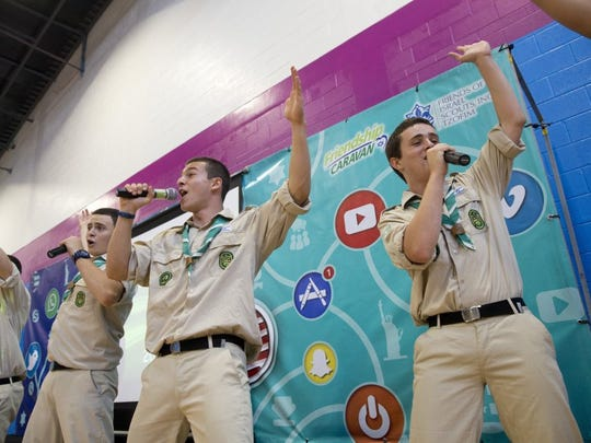 Amit Melamed, from left, Gal Zamir and Yuval Moran, members of the Israel Scouts, sing during a performance held at the Naples YMCA on Thursday. The caravan, made up of 10 Israeli teenagers, travels throughout the United States as ambassadors for Israel, spreading goodwill and friendship. (Luke Franke/Staff)
