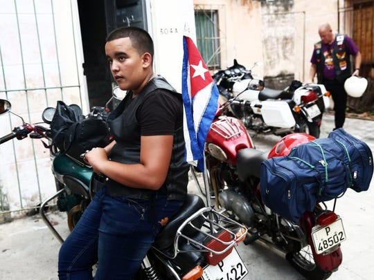 Jose Adrian Acevedo, 14, of JagŸey Grande, Cuba, sits on his family's motorcycle during an Association of Latin American Motorcyclists chapter meeting in Havana, Cuba, on Saturday, March 26, 2016. Some harlistas, or Harley-Davidson bikers, are members of the Association of Latin American Motorcyclists chapter in Cuba. (Dorothy Edwards/Staff)