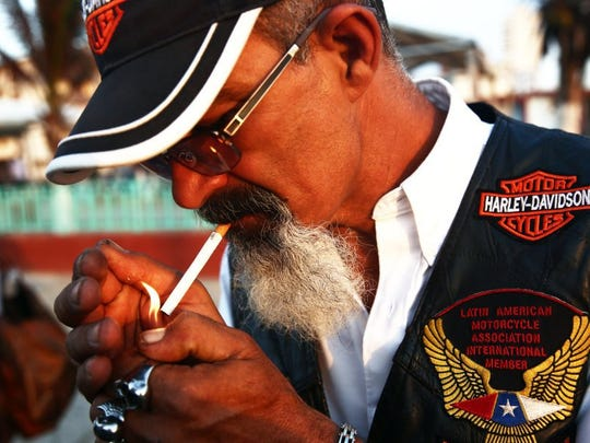 Jose Salgado, of Havana, Cuba, a harlista, or Harley-Davidson biker, lights a cigarette during an Association of Latin American Motorcyclists chapter meeting in Havana, Cuba, on Saturday, March 26, 2016. Some harlistas are members of the Association of Latin American Motorcyclists chapter in Cuba. (Dorothy Edwards/Staff)