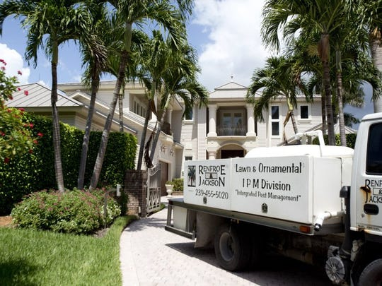 A lawn care company leaves Larry Bird's mansion in Naples on July 5, 2016. The property has been on the market for roughly 2 years, and now is selling for $4.6 million, versus the previous $4.8. (Erica Brechtelsbauer/Naples Daily News)