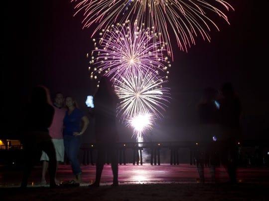 Hundreds gather to watch the Fourth of July fireworks celebration at Naples Beach Monday, July 4, 2016.