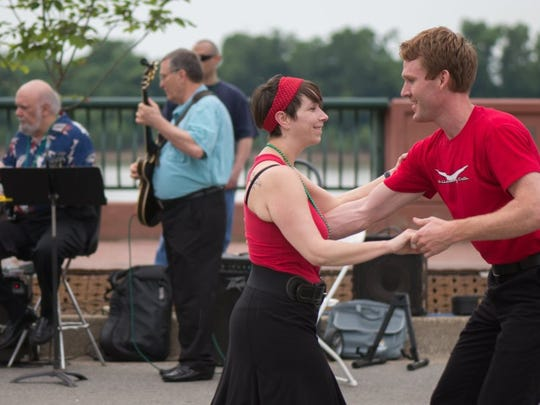 Photos by David Arthur / Special to the Courier & Press Robbie Yates and Elisabeth Klauburg swing dance with the Evansville Swing Cats as the Bob Minnette Ensemble performs behind them during a paste Evening on the River.