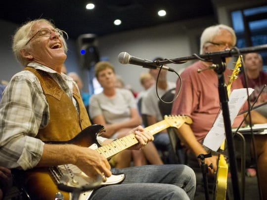 Nashville based songwriter Billy Crain, laughs with other musicians during the Sandy Lee Watkins Songwriters Festival at Rookie's in Henderson last year.