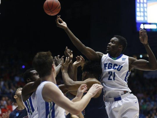 Florida Gulf Coast forward Demetris Morant (21) tips the ball as a scrum battles for the ball during the first half Tuesday, March 15, 2016 at the University of Dayton Arena in Dayton, Ohio. Florida Gulf Coast faced Fairleigh Dickinson in the First Four, a play-in game to the NCAA Men's Basketball Tournament. (Corey Perrine/Staff)