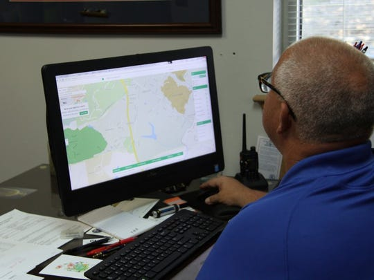 PHOTOS BY ALLISON WELLS/SPECIAL TO INDEPENDENT MAIL Clemson Police Chief Jimmy Dixon looks at a map of neighborhoods on Nextdoor's website.