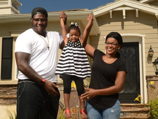 KAREN QUINCY LOBERG/THE STAR Jamon Brown, a guard for the Los Angeles Rams, his daughter Micayla, 3, and wife Micquel Brown play in front of their Dos Vientos house in Newbury Park on Thursday.