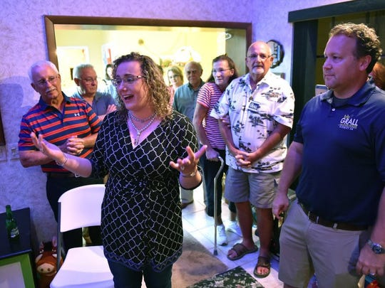Florida House of Representatives District 54 candidate Erin Grall, (center), along with her husband, Michael Bielecki (right), celebrate her win in Tuesday's primary election at their home in Vero Beach. Grall won the Republican primary over challengers Dale Glading, Greg MacKay and Lange Sykes. She will face write-in candidate James Bailey, whose name will not appear on the Nov. 8 general election ballot. To see more photos, go to TCPalm.com. (ERIC HASERT/TREASURE COAST NEWSPAPERS)