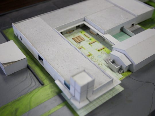 A model shows the design of the new facility at Calvary Rescue Mission that wraps around the current facility. The chapel will remain, with the housing, kitchen and classrooms moving to the new building.