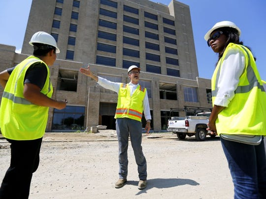 June 13, 2016 - Todd Richardson (center), co-leader of Crosstown development team, stands outside of the Crosstown Concourse during its redevelopment.