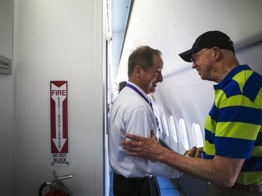 une 16, 2016 - Bob Ranck (left), Brigadier General, United States Air Force (retired), and President/CEO of Orbis, shakes hands with Dr. Steve Charles, with Germantown's Charles Retina Institute, as they stand on the Orbis Flying Eye Hospital at the FedEx Express World Hub Thursday. The MD-10 aircraft is a state-of-the-art surgical and training facility with an operating theatre, sterilization room, a pre-and post-operative care.