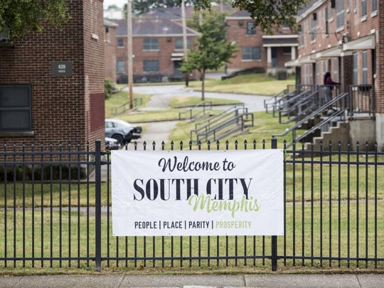 "September 28, 2015 - A large ""Welcome to South City Memphis,"" banner hangs on a fence that surrounds Foote Homes. (Brad Vest/The Commercial Appeal)"