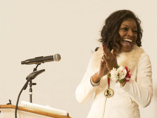 Rev. Renee Kesler emcees the Martin Luther King Jr. Memorial Tribute Service at Greater Warner Tabernacle A.M.E Zion Church on Monday, January 18, 2016.