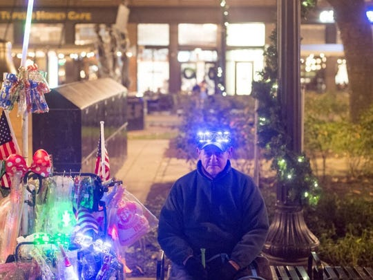 Waiting to sell New Year's Eve trinkets at Market Square, Thursday, December 31, 2015.