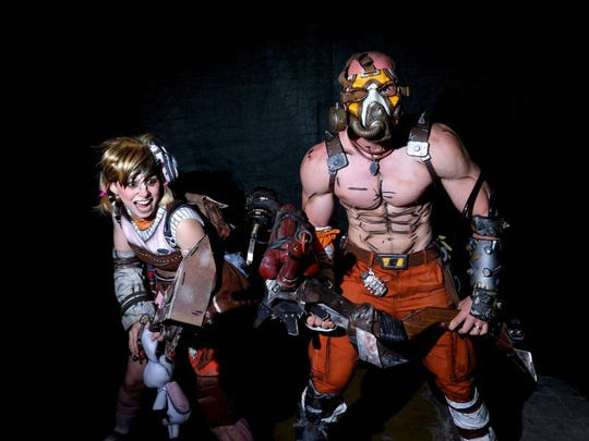 Pictured is Lauren Brandt as Tiny Tina and Ethan Brandt as Kreig from the Borderlands video game during the Marble City Comicon at the Knoxville Expo Center on April 23, 2016.