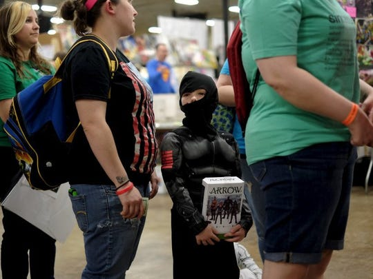 Braydin Sammons, 7, as Snake Eyes, waits in line to