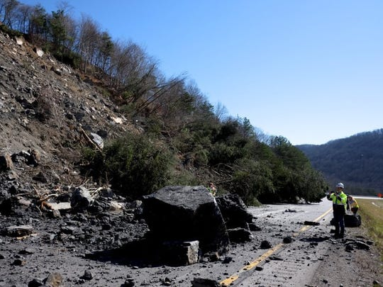 Mark Nagi, Tennessee Department of Transportation spokesman, takes a photo of the damage from Friday's slope slide on Interstate 75 North at mile maker 142 in Campbell County, on Sunday, Feb. 28, 2016. I-75 will remain closed in both directions through Monday and motorist could see closures for weeks to come as TDOT geotechnical engineers evaluate the slide. (Shawn Millsaps/Special to News Sentinel)