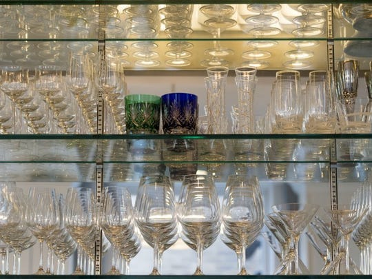 The glassware on the bar-s mirrored shelves sparkles. The nook in the kitchen where the Hawks installed the bar was originally designed to be a coat closet. -You can throw coats on the bed,- says Jacque.