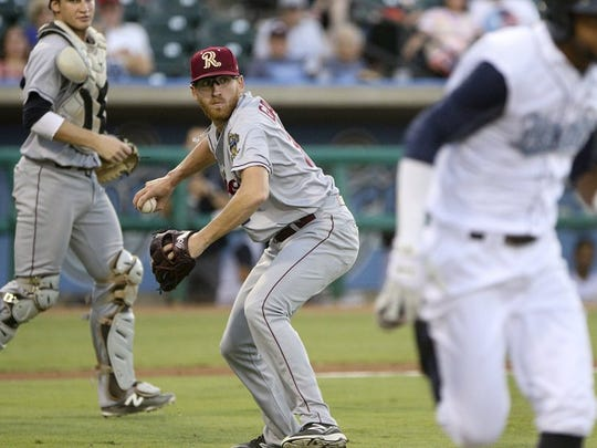 GEORGE TULEY/SPECIAL TO THE CALLER-TIMES Frisco pitcher Reed Garrett (center) throws out Danry Vasquez (R) at first to end the fourth inning at Whataburger Field in Corpus Christi, Saturday, July 16, 2016.