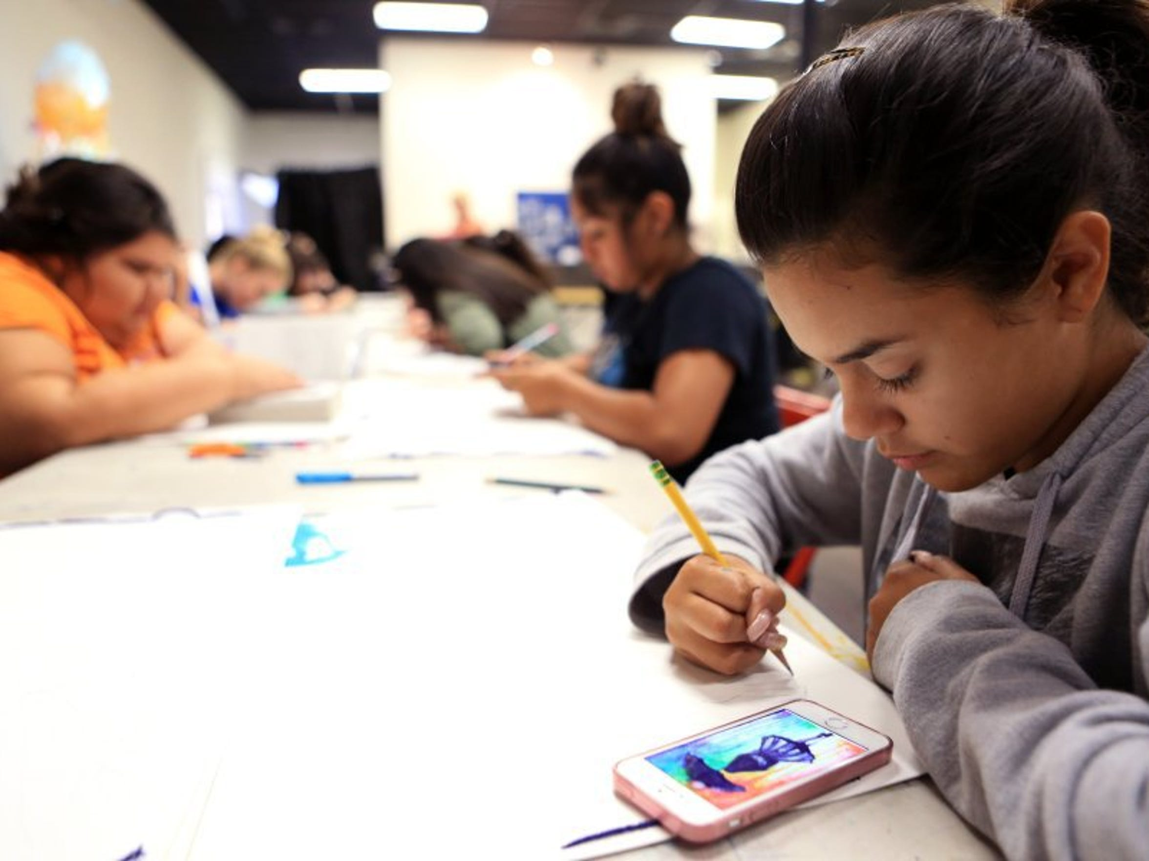 Rachel Denny Clow/Caller-Times Selena Loza, 13, draws an outline while working on a portfolio during downtime in a printmaking art camp at K Space Contemporary on Monday, July 25, 2016. This is the last week the art gallery is hosting summer art camps.