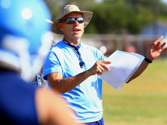 GABE HERNANDEZ/CALLER-TIMES Carroll head coach Jerry Long talks to his players during practice Tuesday, Aug. 2, 2016, at Carroll High School in Corpus Christi.