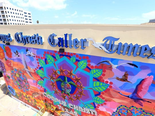 """The Caller-Times has a mural that celebrates the beauty of the area called """"Endless Sunset: The Colors of Our City."""""""