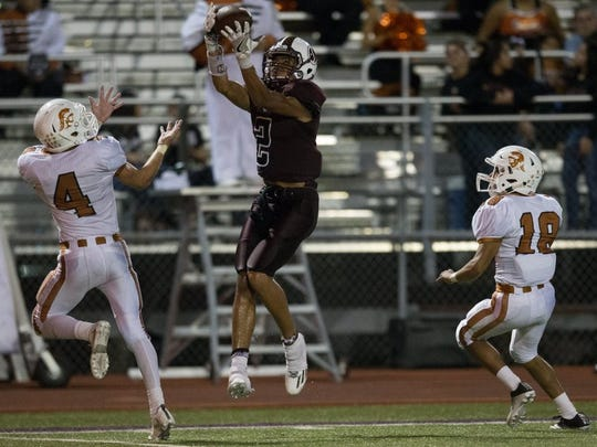 COURTNEY SACCO/CALLER-TIMES Sinton's Andrew McGowan jumps to catch a pass for a first down during the third quarter of their game against Beeville at Pirate Stadium in Sinton on Friday, Sept. 16, 2016.