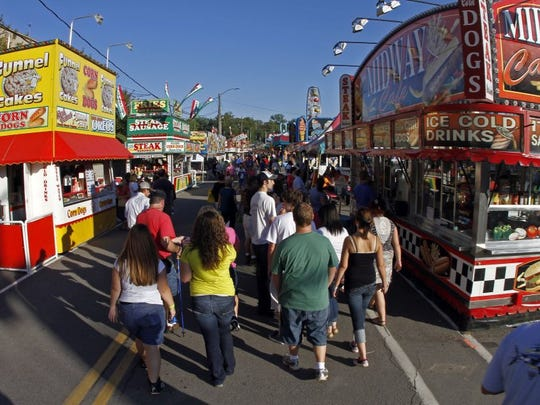 People walk through the midway during the Tennessee Valley Fair on Sept. 7, 2012.