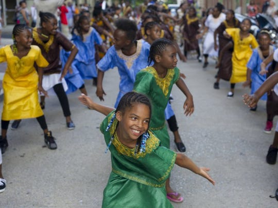 SAUL YOUNG/NEWS SENTINEL Young members of the Kuumba Watoto Dance and Drum line dance along Market Street in the Kuumba Junkanu parade in 2013.