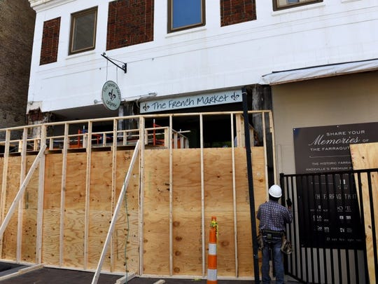 The owner of the Farragut Hotel is having a dispute with the French Market on Gay Street and has had workers build a covered walkway that conceals the entrance of the restaurant.