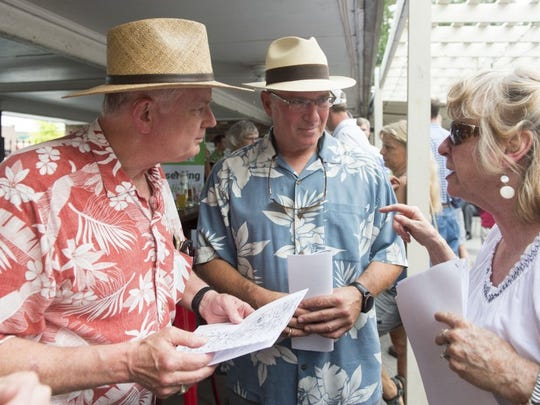Terry Faulkner, right, president of the Bearden Council , gives Bryce Giesler, left, and City Councilman Nick Pavlis a brief history of the Bearden area before they begin of a walking tour of the neighborhood on Tuesday, June 14, 2016, from the Bearden Beer Market. Bike Walk Knoxville is hosting four bike and walking tours this summer of area neighborhoods. (SAUL YOUNG/NEWS SENTINEL)