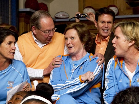 Chancellor Jimmy Cheek congratulates Tennessee head coach Pat Summitt on Monday, March 12, 2012, after the Lady Vols received a No. 2 seed in the NCAA tournament. Looking on are assistant coach Mickie DeMoss, left, and associate head coach Holly Warlick. Tennessee athletic director Dave Hart is in the background. (SAUL YOUNG/NEWS SENTINEL)