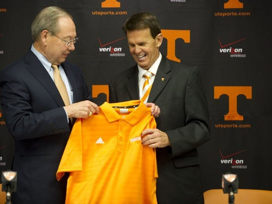 Dave Hart, right, is presented an orange shirt by UT Chancellor Jimmy Cheek during a press conference introducing Hart as UT's vice chancellor of athletics on Monday, September 5, 2011. (Saul Young/News Sentinel)