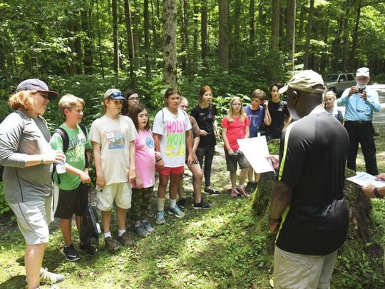 Park Superintendent Cassius Cash swears in a class of certified Junior Naturalists Thursday, July 14, 2016, in the Greenbrier district of the Great Smoky Mountains National Park. The middle school-age students received their certification through a program sponsored by the Smoky Mountain Field School and University of Tennessee Kids U. The Junior Naturalists are, from left, Jackson Bushore, Cohen Matevey, Jasper Barnes, Lilly Atchley, Katie Gibbons (back), Christina Casey, Raven Dixon, Abigail Myers, Natalie Myers, Kaleb Styles, Tyler Barnes, and Grace Dixon. (PAUL EFIRD/NEWS SENTINEL)