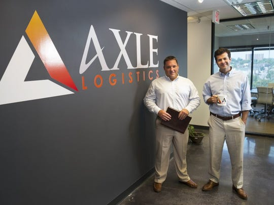 Axle Logistics co-founders Jon Clay, left, and Drew Johnson are pictured July 18 at the company's headquarters in the Langley Building. Axle Logistics provides transportation services to customers in the United States, Canada and Mexico. (PAUL EFIRD/NEWS SENTINEL)