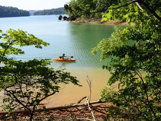 Wesley Woods paddles on Norris Lake as seen from the new 2.5-mile Elkins Trail .