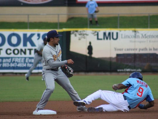 Tennessee's Trey Martin slides into second base against