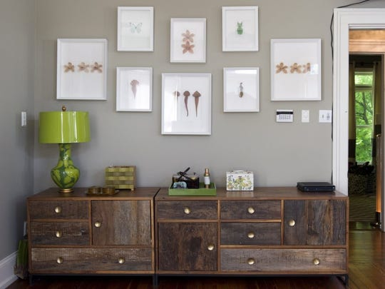 The long dresser—actually two pieces—was purchased to fill a large wall in their previous home in Holston Hills. 'Fortunately, it works here, too,' says Lisa. Specimen artwork on the wall was created by Christopher Marley. (SAUL YOUNG/NEWS SENTINEL)