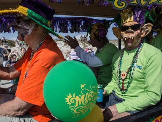 CALLER-TIMES FILE Revelers enjoy the Barefoot Mardi Gras parade. On Saturday, more than 50 walking groups, vehicles, golf carts and floats will caravan down the beach during the seventh annual Barefoot Mardi Gras parade.