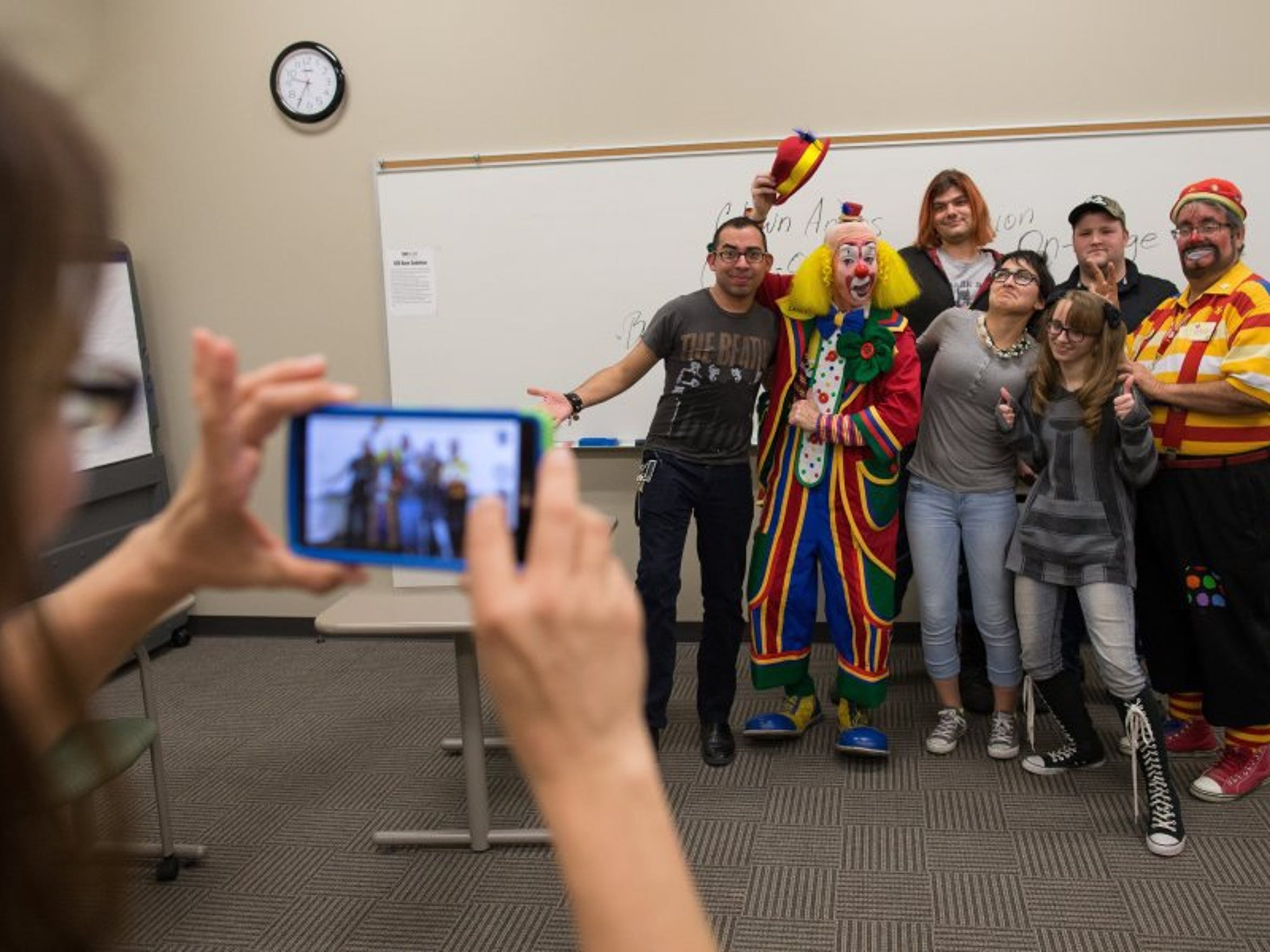 COURTNEY SACCO/CALLER-TIMES Denise Underwood (from left) of Odem takes a photo of Orlando Valdez; Danny Kollaja, in character as Lanky the Clown; Benjamin Woodard; Christina Moreno; Katie Lynn Underwood; Ben Abbott; and Mark Johnson, in character as Bingo, at the end of their first Clown Class on Tuesday, Feb. 9, 2015, at Del Mar College in Corpus Christi.