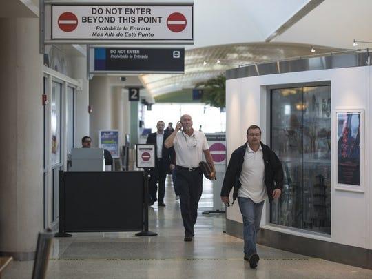 CALLER-TIMES FILE Passengers depart their plane at the Corpus Christi International Airport.