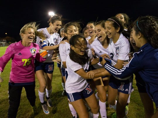 Veterans Memorial players, with Jade Piper in the middle, celebrate after they defeated Brownsville Porter in a 5A area-round playoff match.