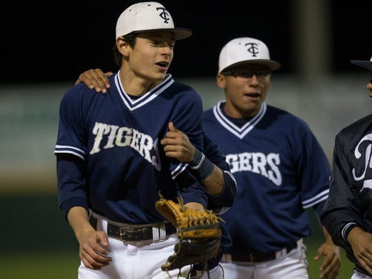 COURTNEY SACCO/CALLER-TIMES Carroll center fielder Michael Garza (left) accepts congratulations from teammates after throwing out King's Alec Soliz at third base for the final out in the fifth inning Friday night.