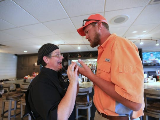 Gail Huesmann (left), executive chef at Black Marlin Bar and Grill in Port Aransas, talks with customer Leon Laskowski on Tuesday, April 4, 2016. Laskowski said he never would have ordered what she made because there were at least five things he doesn't like, but the way she put it together was amazing and he would eat it again.