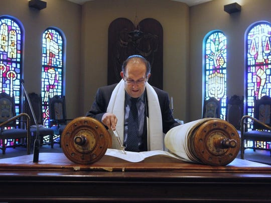 Rachel Denny Clow/Caller-Times Rabbi Ilan Emanuel, with Congregation Beth Israel, reads from the Torah on Tuesday, September 23, 2014, while preparing for Rosh Hashana, or the Jewish New Year.